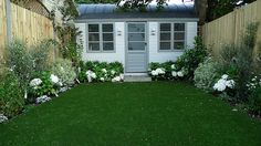 artificial easy grass lawn summer house sandstone paving and white flower planting scheme (4)