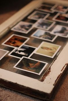 A way to arrange a family tree- pictures staggered under a large glass frame