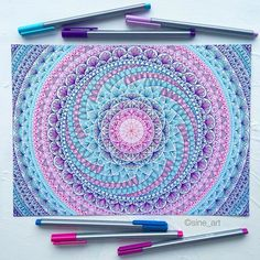 Love the teal, pink, purple and blue of this mandala design, so bright! Great for mindfulness this coloring in! Repin this for later.