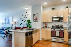 Each home features granite countertops with a breakfast bar, washer and dryer, USB power outlets, and a private balcony. Two Bedroom Floor Plan, Valley Forge, Apartment Communities, Luxury Apartments, Granite Countertops, Outlets, Apartment Living, Washer And Dryer, Balcony