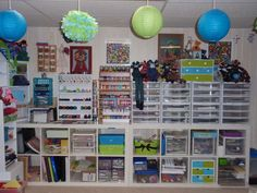 scrapbook organization  ** like the short book case from Ikea then put carts on top