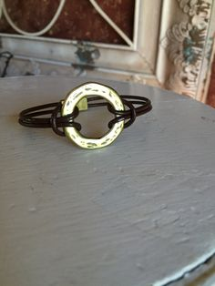 Leather Bracelet with Antiqued Gold Infinity Circle and Magnetic Clasp by RaeLynnJewelry on Etsy