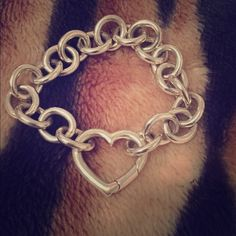 "Tiffany & Co Round Link Heart Bracelet Stealing silver Round Link Heart bracelet. 7.5"" long. Only worn about 2 times and it's been sitting in my jewelry box for years. Paid over $300 and I can't believe I'm selling this. Went online to check if item was available and it isn't anymore. Willing to trade only for Michael Kors gold watch model #MK5055 no other trades accepted, sorry! Tiffany & Co. Jewelry Bracelets"