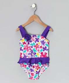 A kid-appropriate swimsuit. (What a novel idea compared to some of the stuff out there now!)  Violet Floral Skirted One-Piece Swimsuit - Infant, Toddler & Girls