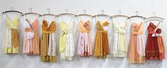 Armour sans Anguish eco-friendly bridesmaids dresses in pale yellows, deep marigolds, peaches, and deep orange.