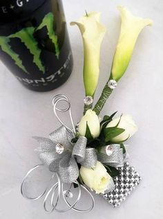 Sophisticated prom corsage with calla lilies, roses, crystals and wire. #prom @cactusflower