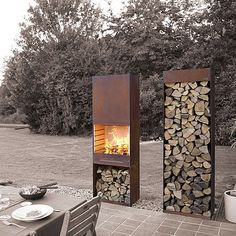 by François Royen by TOLE the outdoor living experienceArchiExpo TOLE Garden Fire & Barbeque – Corten steel outdoor fireplace and firewood storage
