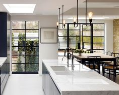 On The Square With Stiff + Trevillion Light floods this stunning kitchen through the industrial Crittall windows. Project by Stiff + Trevillion. Photograph by Kilian O'Sullivan. Home Decor Kitchen, Kitchen Furniture, Kitchen Interior, Home Kitchens, Small Kitchens, Kitchen Ideas, Küchen Design, House Design, Interior Design