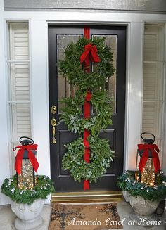 Entry Door - multiple wreaths on door and urns with wreaths for lantern rings