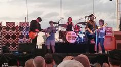 Cheap Trick ~ July 2013 with special guest, a 12 year old boy from the audience got to play his guitar with them. He was great!