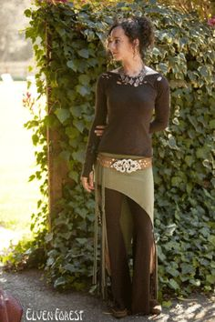 This is a delightful addition to any outfit, an asymmetrical earthy skirt to wear over pants, tights, the right long skirt. Great for layering with anything. Features two braids on the shorter side. T