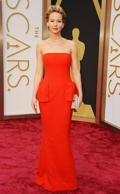 Jennifer Lawrence, in a Dior dress, Neil Lane jewels, Brian Atwood shoes, and a Ferragamo clutch, attends the Oscars held at Hollywood & Highland Center on March 2, 2014 in Hollywood, California. (Photo by Jason Merritt/Getty Images)