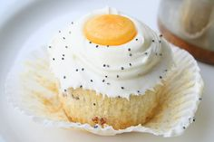 """Bacon Cupcakes: Sunny Side Up - """"That's So Michelle"""" Blog - Michelle used a regular white cake box mix but added some bacon and maple syrup. The egg yolk is a butterscotch candy. The """"pepper"""" on the """"egg"""" frosting is poppy seeds. Very Creative!!"""