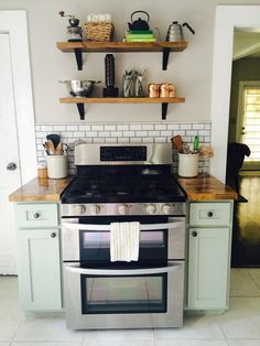Bungalow Kitchen Reno: The Reveal {Use Your Words, Little Girl blog} // butcher block counter stainless subway tile modern classic