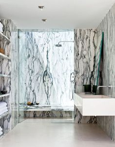 Stunning marble. The bathroom is so simply designed but so dramatic because of the heavily veined stone. Love the open shelves.