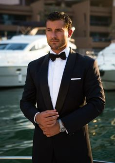 James Bond inspired Midnight blue tuxedo with black satin shawl lapel. 100% Italian Wool from Reda.