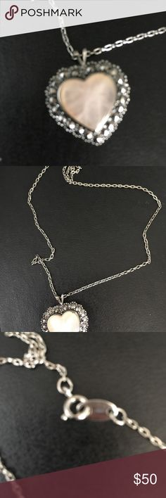 Sterling silver chain and pendant Sterling silver chain and pendant is beautiful shade of pink inside the stone for the heart Jewelry Necklaces