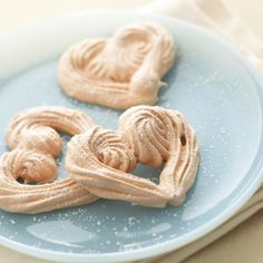 Valentine messages written on parchment strips are neatly tucked into each of these individual meringues. A fun dessert for kids.