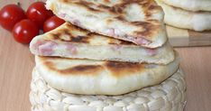 This ham and cheese stuffed pita bread is one of my favorites. It's very tasty, fluffy, with a creamy filling and very easy to make. Use your favorite cheese and your favorite ham, fill the pita br… Bakery Recipes, Bread Recipes, Cooking Recipes, How To Cook Ham, How To Make Cheese, Still Tasty, Romanian Food, Pastry And Bakery, Pita Bread