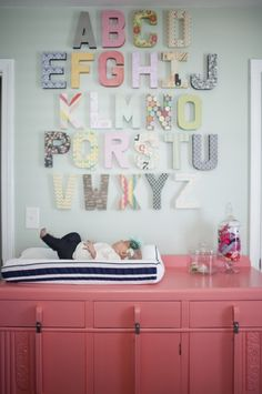 We're loving the combination of mint + pink and this awesome alphabet wall. #ProjectNursery #BabyCenterBlog