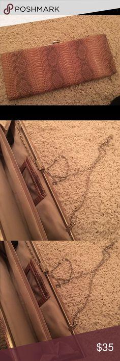 Snakeskin Shoulder Clutch Never worn snakeskin clutch ! New. Super stylish never worn Bags Clutches & Wristlets