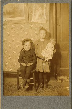 Girl with Little Brother & Dolly by KID DEUCE, via Flickr