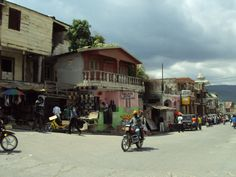 the streets of Jacmel. I so could get used to cruising around this little town on a moto! Haiti And Dominican Republic, Caribbean, Cruise, Novels, Street View, Island, History, Pearl, Travel