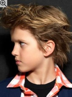 Boys haircut with the hair styled backwards. The hair is layered and ruffled for a cool wild look.