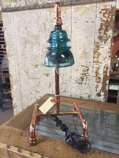Copper light and glass insulator by Keith