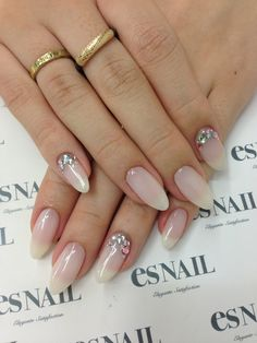Nude bling almond nails