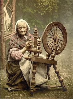 Irish Spinner and Spinning Wheel. Co. Galway, Ireland dated between 1890 and 1900