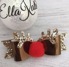 A cute Rudolph style hair bow The details: - bow measures 3.5 x 1 inches - made with high quality materials - bow be attached to a toothed hair clip or one size fits all nylon headband in red or nude - handmade for you in the U.K. Safety: Please always supervise babies and children