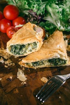 Spinach and Cheese Filo Triangles. A winning combination of fresh spinach, feta, ricotta and a little parmesan, wrapped up in a pleasing triangle for one (2 in a package). The filo is layered with a little olive oil, rather than buttering every layer. Fifty minutes or so in a hot oven and you'll have flakey, golden brown triangles, and dinner on the table.