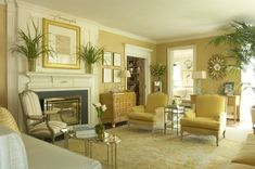Jan Showers living room is a study in layering with many shades of gold, yellow and white. Supporting all of this is a beautiful gold Oushak rug.