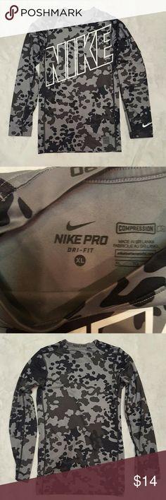 Boys Nike  camo compression shirt Super cute nike compression shirt.  Black and gray camo. Excellent condition. Nike Shirts & Tops