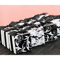 Decorative black and white flourish design is printed on the reversible wraps of these white boxes.  Mix and match the coordinating patterns to create the perfect look.  Black satin ribbon and double-sided tape included.  #timelesstreasure