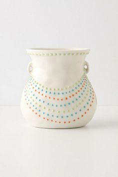 lovely but discontinued. reminds me of those candy dots which were fun even though impossible to eat without getting a mouth full of paper too. Winking Luce Vase #anthropologie