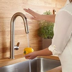 Making a mess? No need to reach for the handle on this Beale touchless kitchen faucet #sleek #now @american_standard. Perfect for today's modern kitchen. For more modern kitchen inspiration head over to our Pinterest page JeffreyCourtHD.