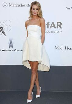 Rosie Huntington-Whiteley, Cannes Film Festival 2013   Rosie Huntington-Whiteley in a strapless white, asymmetric Christian Dior dress at the amfAR Gala at Cannes.