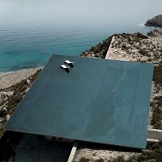 """Designed by Kois Associated Architects for the Greek island of Tinos, a square-shaped infinity pool conceived as an """"invisible oasis"""" would form the roof of the cavernous dwelling"""
