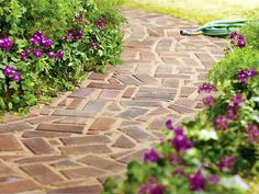 A beautiful brick path - I want to do this at our house!  Love the asymmetrical pavers on this walking path.