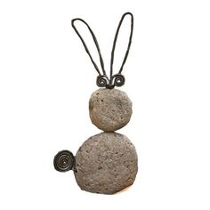 Ancient Graffiti Critters Rabbit Natural River Stone with Wire by Ancient Graffiti. $22.00. Measures 1-inch l x 5.5-inch w x 11-inch. Created using natural materials. Nature-inspired gifts. Creates an artistic blending of your style and garden environment. Ancient Graffiti critters rabbit natural river stone with wire. This nature-inspired gift and accessory for your garden is created using natural materials. Handcrafted to create an item that is handsome, built ...