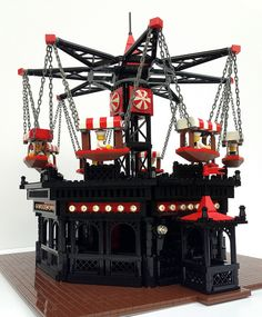Side View of the Flying Swings ride from my LEGO Coney Island showing the ride illuminated with miniature Tivoli lights