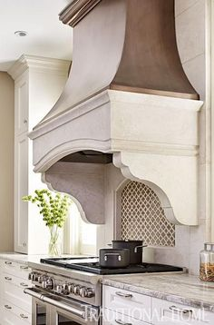 Gorgeous Range, countertops, cabinets, backsplash, stove - Elegantly Renovated Kitchen | Traditional Home - Francois & Co Hood - Toulouse Shelf, Concave Stack and KB500 Corbels