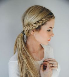 Front braid with a low pony.