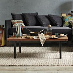 Industrial Coffee Table | west elm $319 Natural saal wood top with oil finish; iron frame and legs.