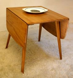 Ecrol drop leaf table. Just scored a table exactly like this in perfect condition for $3.75 at Salvation Army. Score!
