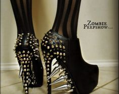 These ZombiePeepshow Chromium platform pumps are customized with pyramid studs, spikes, zipper, metal, skull pieces, and paint. These were custom made for a client, so each pair I make will be different. The final product you receive will have slight variances (ie, positioning of spikes, varying chain, etc.) so that no two pair of heels are the same.  The pump may vary from single, double, or no strap depending on availability for this design.  If you need your item for an upcoming event, a…