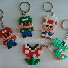 Super Mario keyrings hama mini beads by piligonzalez. Melty Bead Patterns, Hama Beads Patterns, Beading Patterns, Perler Earrings, Yoshi, Perler Bead Mario, Minis, Beading For Kids, Peler Beads