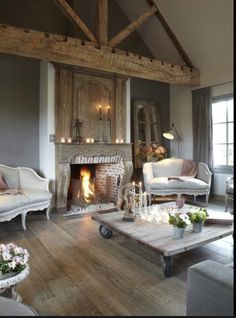 Grey aged timber fireplace, timber work is beautiful, this could work if stone cost proves prohibitive.